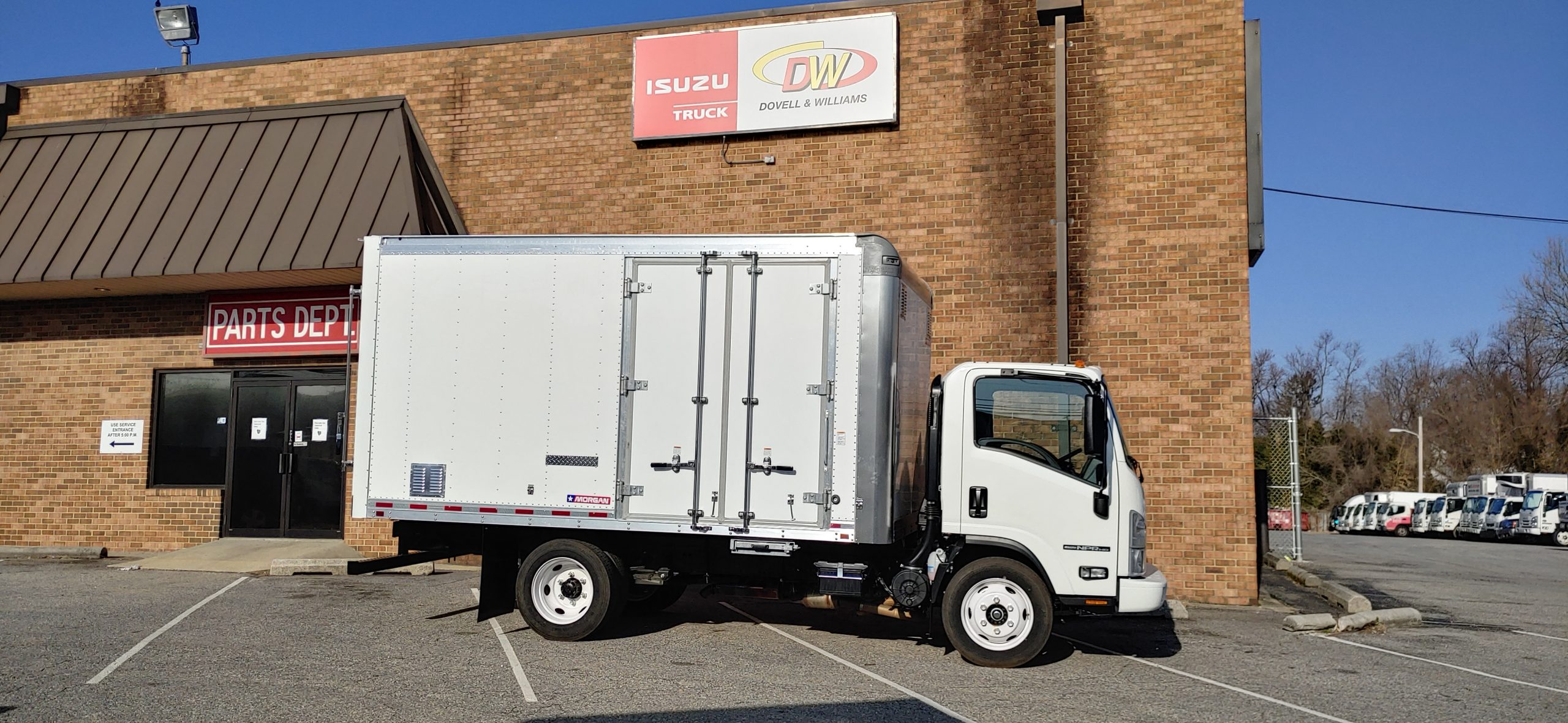 2021 NPR HD Gas Truck with Proscaper Body Pull down Ramp with Side doors 3 year Roadside Assistance 20210304_084647_HDR-scaled